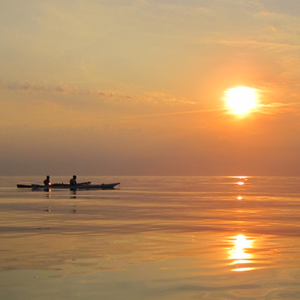 Solnedgang på vestkysten med Paddle Bornholm